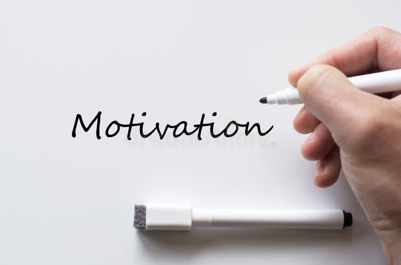 Motivation som är skriftlig på whiteboard royaltyfri foto