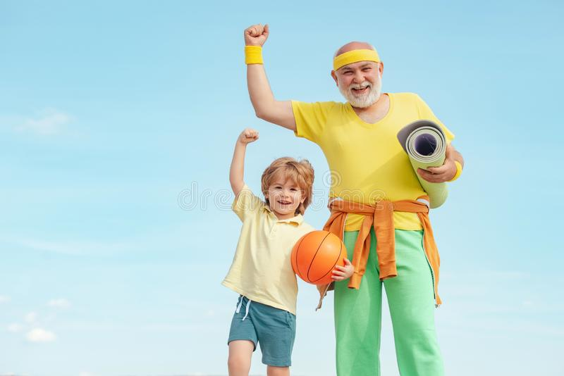 Motivation and sport concept. Sport exercise for kids. Grandfather and son doing exercises. I love sport. Outdoor. Activities and healthy lifestyle royalty free stock photo