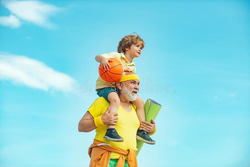 Motivation and sport concept. Sport exercise for kids. Grandfather and son doing exercises. I love sport. Outdoor. Activities and healthy lifestyle stock photo