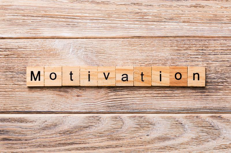 Motivation word written on wood block. Motivation text on wooden table for your desing, concept.  royalty free stock images