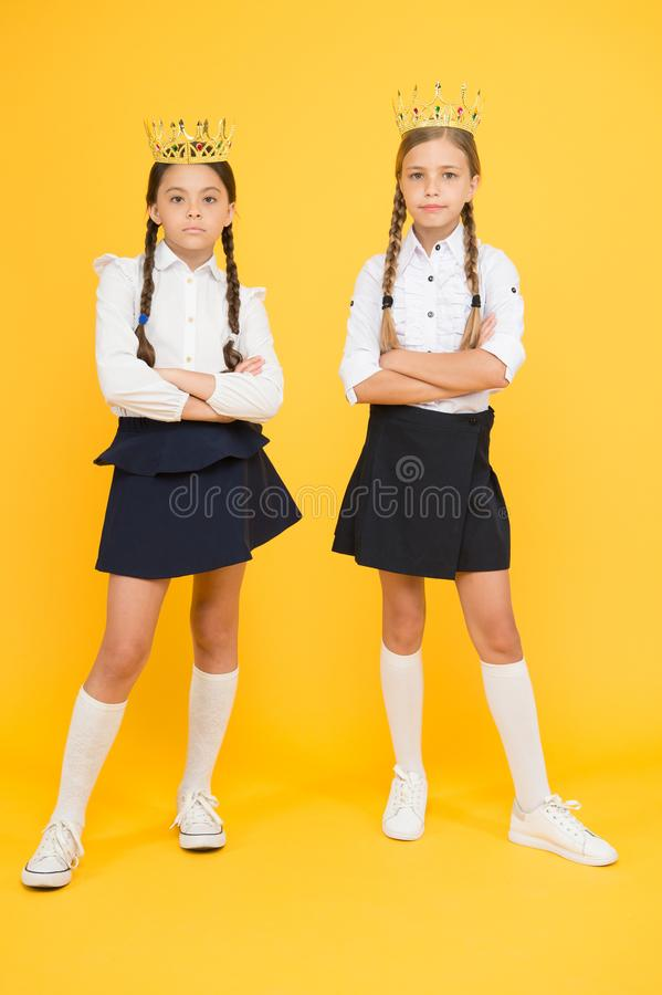 Motivational award for school children. Girls kids imaging luxury lifestyle. Award coronation. Brilliant pupils. Schoolgirls wear golden crowns symbol of stock photos