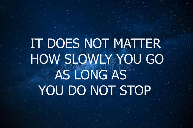 Motivational and inspiration quote. Motivation in life and business. It does not matter how slowly you go as long as you do not royalty free stock photography