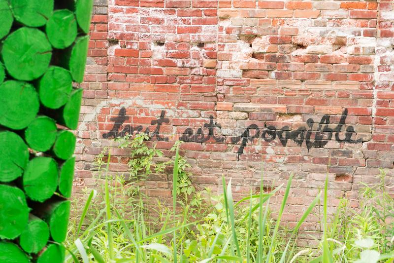 motivational positive quote french possible brick wall green painted logs foreground royalty free stock photos