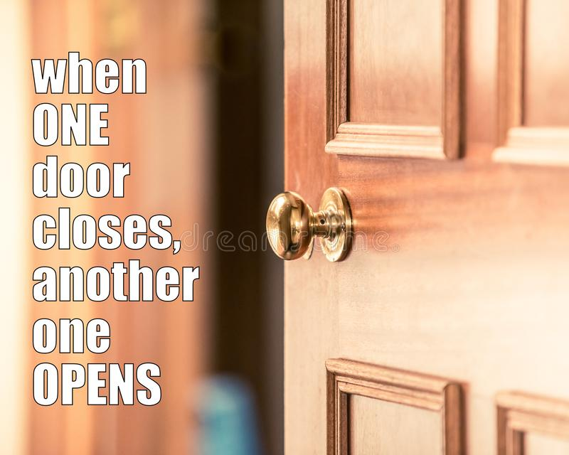 Motivational quote - when one door closes another one opens. Opportunity quotes, new life challenges quote. Never give up and keep. Going forward, never give up stock photo