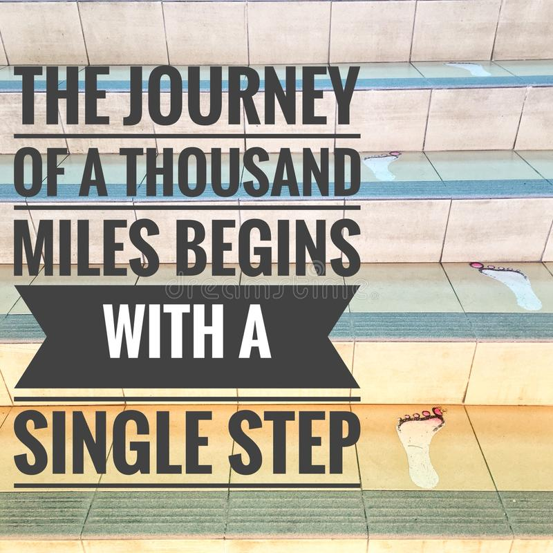Motivational quotes of the journey of a thousand miles begin with a single step stock images