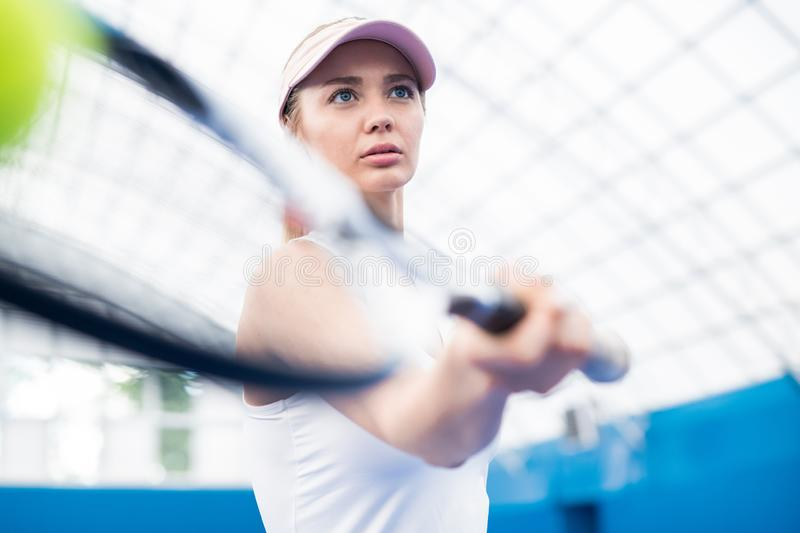 Motivational Shot of Woman Playing Tennis stock images
