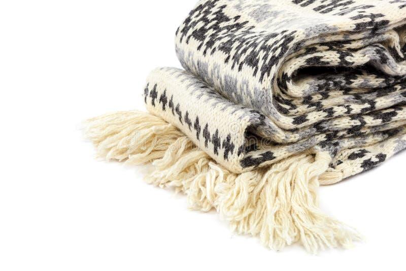 Motley связанный шарфом на белой предпосылке стоковые фото