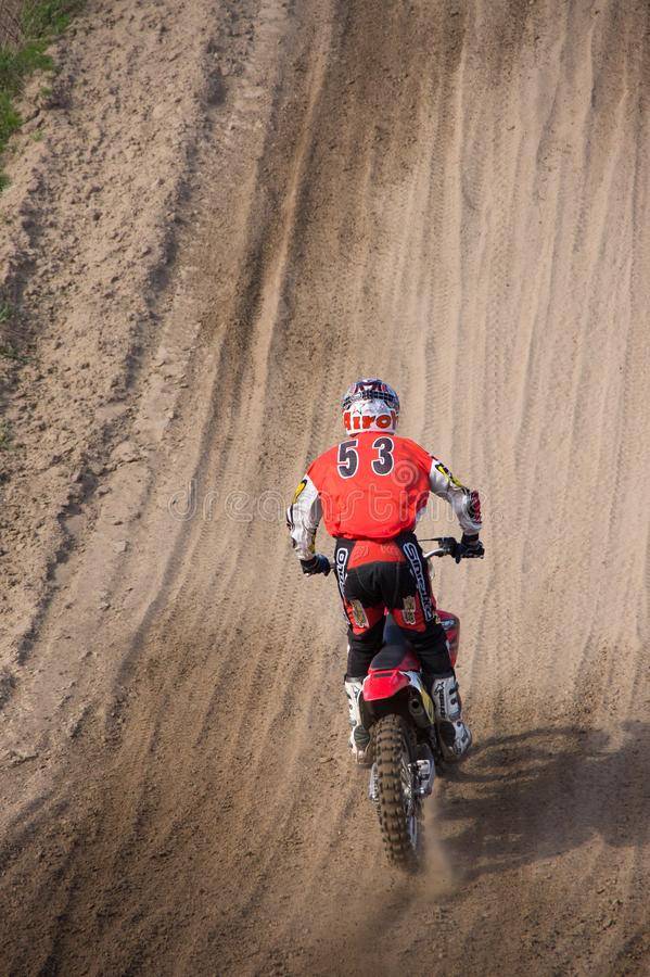 Moto Cross Driver driving up a hill royalty free stock photography