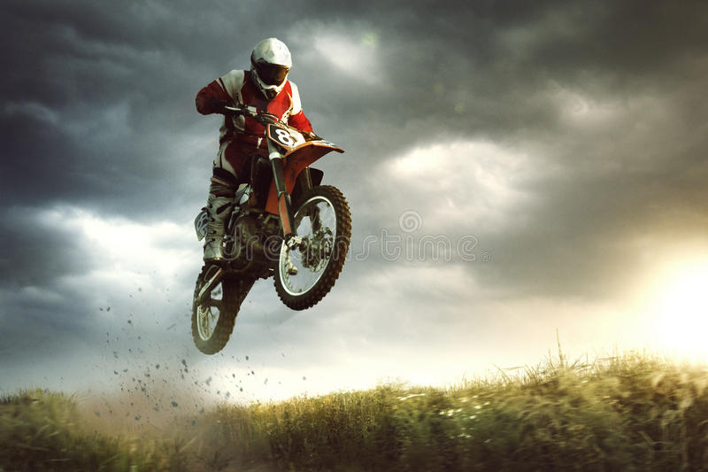Moto cross. A picture of a biker making a stunt and jumps in the air stock photos