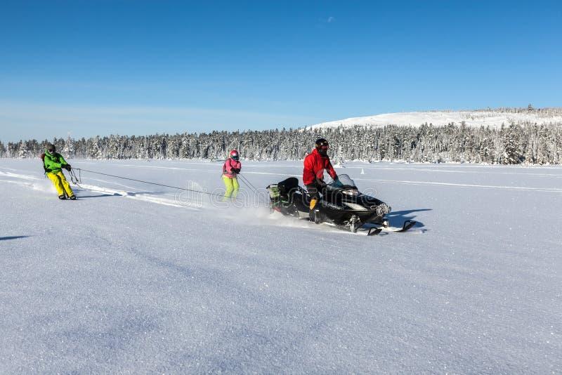 Moto de nieve en el bosque fotos de archivo libres de regalías
