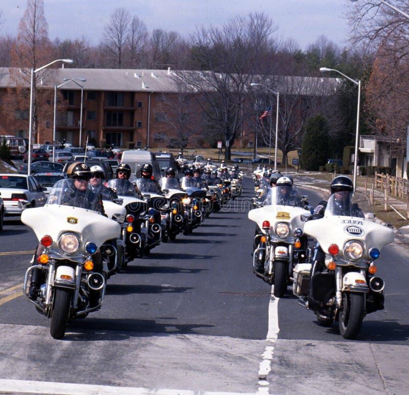 Moto de police dans un enterrement photographie stock libre de droits