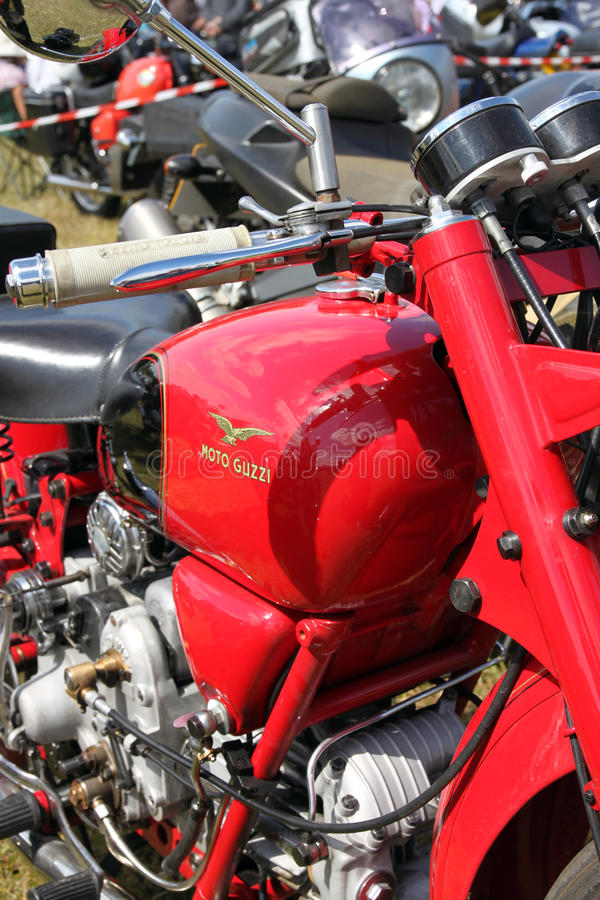 Moto Guzzi Falconi 500cc vintage motorcycle. Red petrol tank with Moto Guzzi logo and single cyclinder engine royalty free stock photos