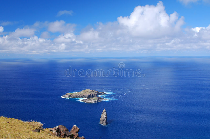 Moto Nui islet on Easter Island. View of Moto Nui from Orongo ceremonial village on Rapa Nui (Easter Island) site of the Birdman contest stock photography