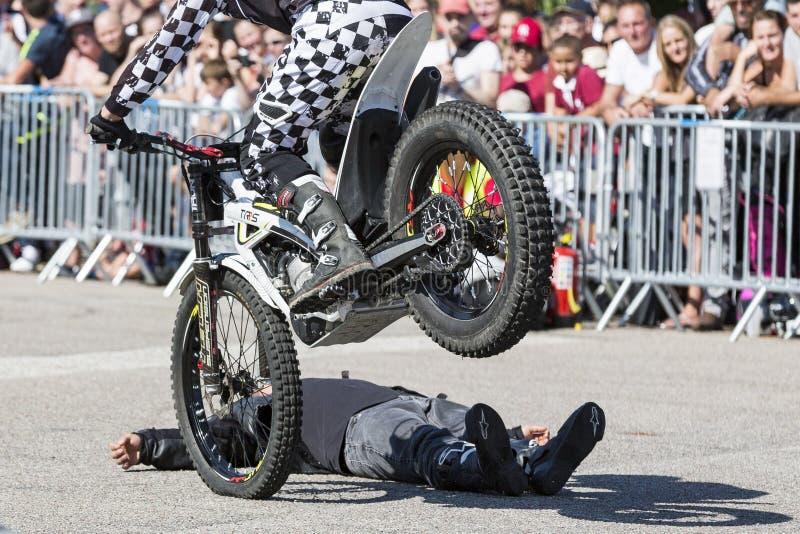 Moto-show in central square of city. Tricks on ATV stuntmen, Stunt man motorbike Riding - Wheelie, Stoppie and extreme acrobatics royalty free stock photos