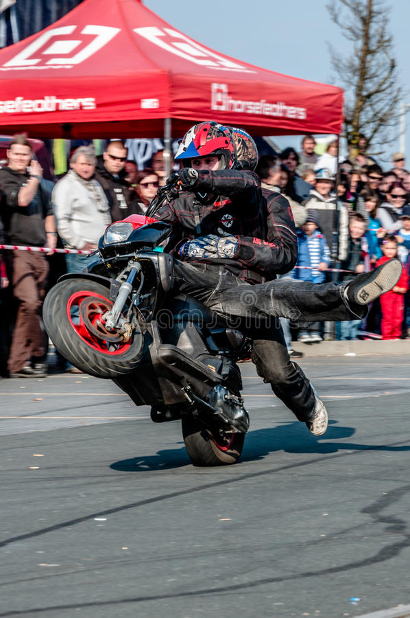 Download Moto stunt-riding editorial stock image. Image of chain - 24599614