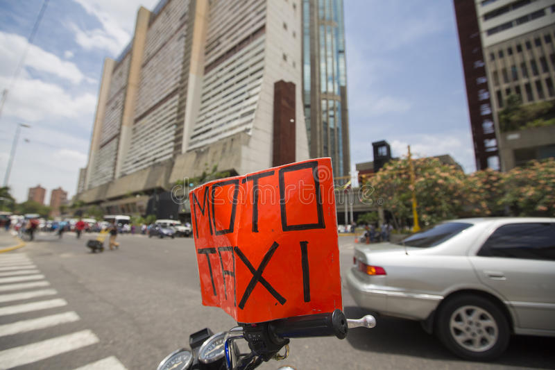 Moto taxi sign standing on a motorbike, Caracas royalty free stock images