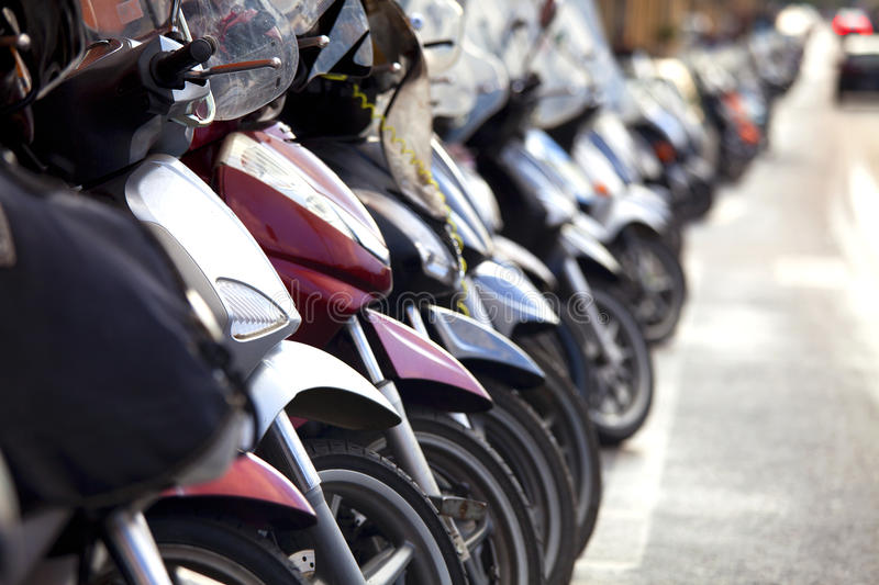 Motobikes. Motorbikes standing in the parking lot royalty free stock image