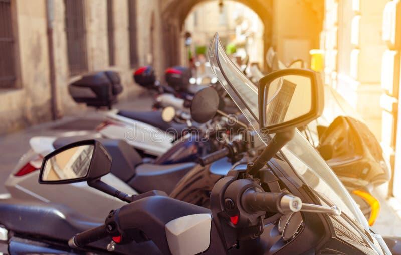 Motorbikes parked in narrow street. Motorbikes parked in the narrow street royalty free stock photography