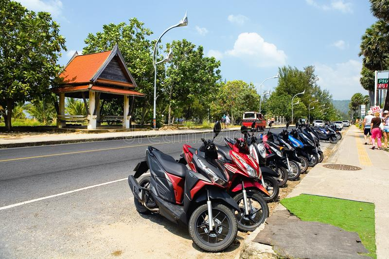 Motobikes parked near the sidewalk. Thai Karon. stock photos