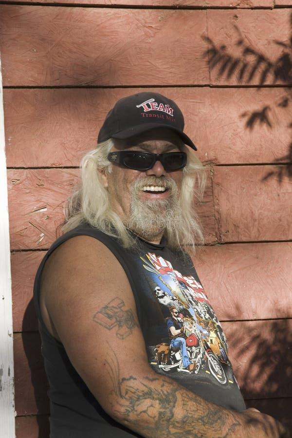 Motociclista com tatuagem foto de stock