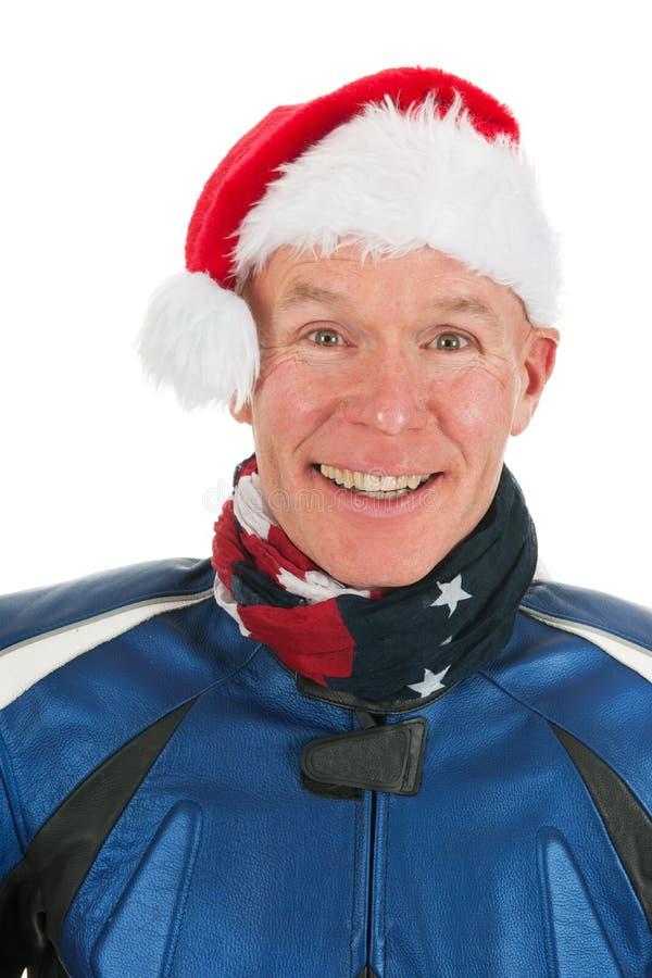 Motociclista del motore del ritratto come Babbo Natale fotografie stock