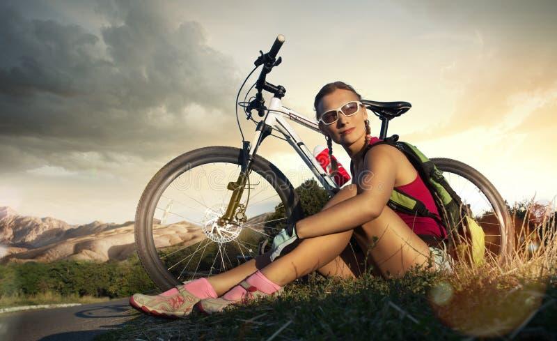 Motociclista della donna immagini stock
