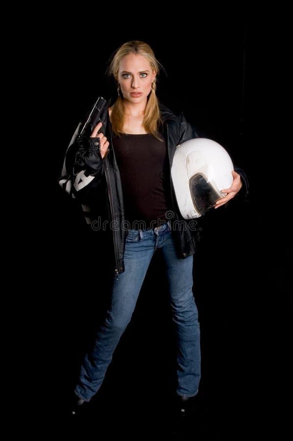Motociclista femminile con una pistola fotografia stock libera da diritti