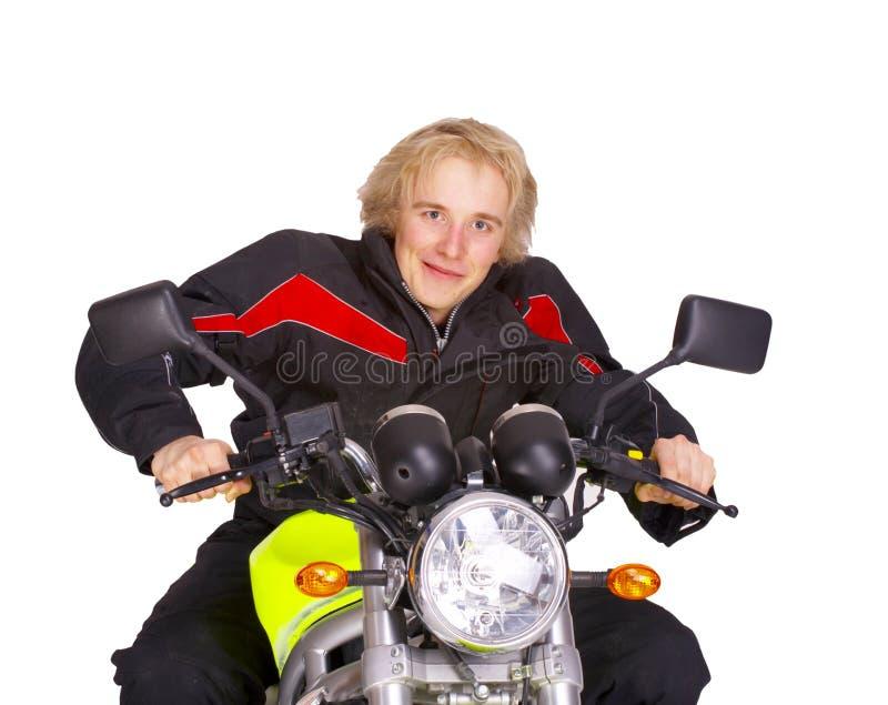 Motociclista su priorità bassa bianca immagine stock