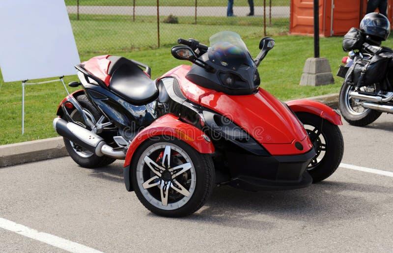 Motociclo della ruota di rosso tre fotografia stock libera da diritti