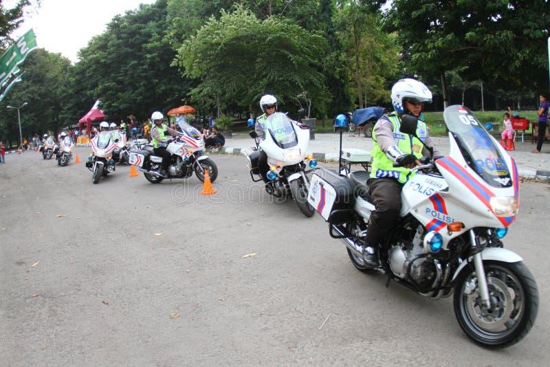 Motociclo di guida della polizia fotografie stock libere da diritti