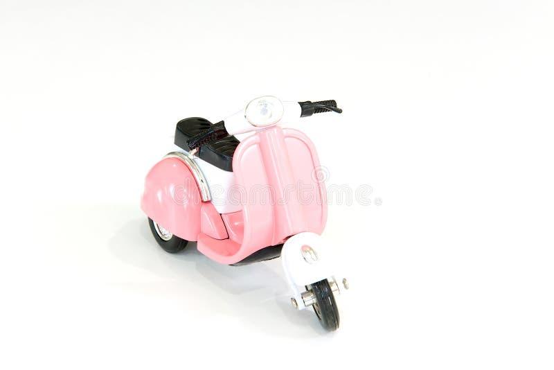 Motociclo rosa del giocattolo fotografia stock libera da diritti