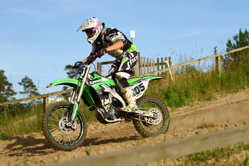Motocross. An anonymous motocross rider on a green bike. Picture taken during practice at a danish motocross club. Motocross is a form of motorcycle racing held stock image