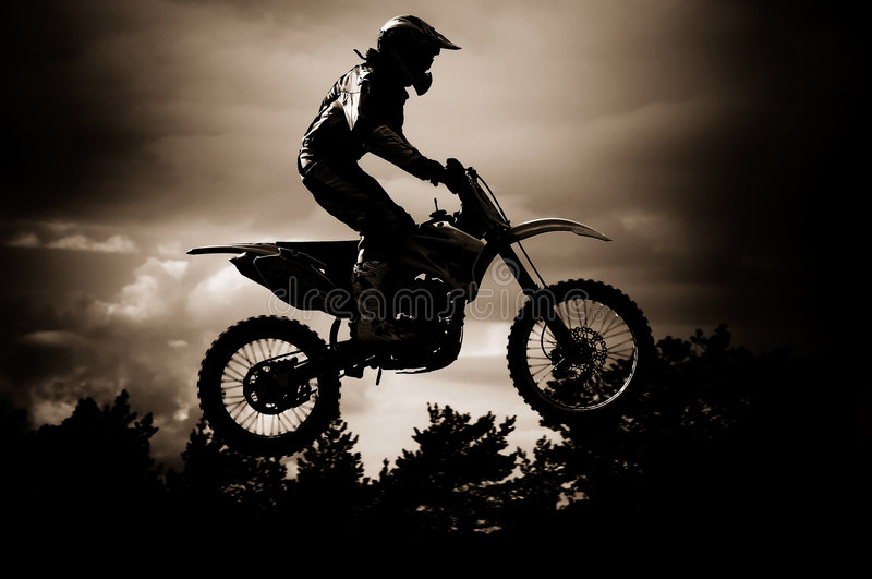 Motocross. Rider in a dirt track race royalty free stock photos