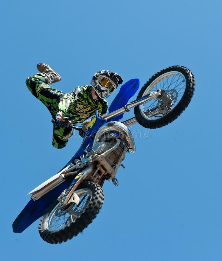 Motocross against blue skies stock image