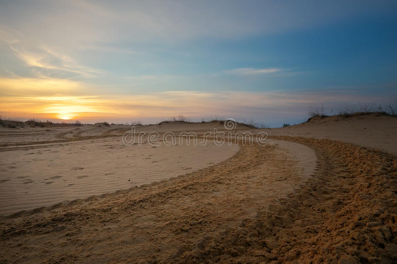Motocross and auto sport track with sunset sky background. stock photography