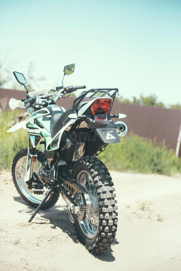 motocross bike stands on a sandy road stock images
