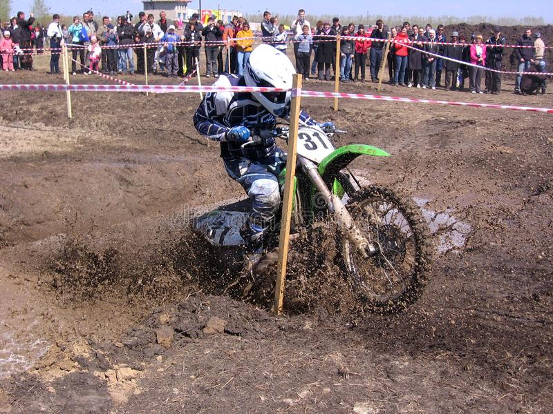 Motocross competitions  the Novosibirsk region in 2013, the athlete participant overcomes a dirty obstacle course on a stock photos