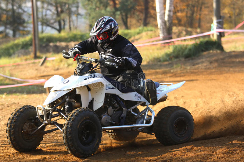 Quad race. In ZABREH, CZECH REPUBLIC - OCTOBER 30. Motocross race called the Zabrezky motocross. Unidentified racer riding a quad. The race went up in Zabreh stock photo