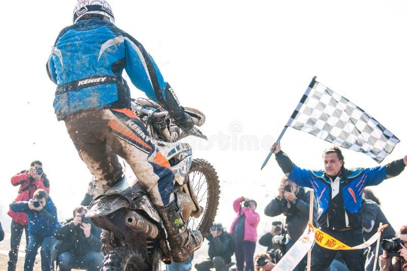 Motocross racer on finish stock photo