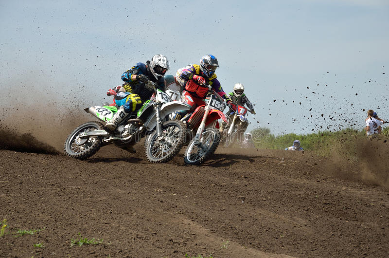 Motocross racer first corner after the start stock image