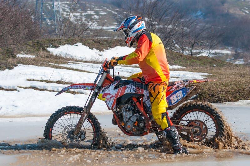 Motocross racer on frozen lake stock photo
