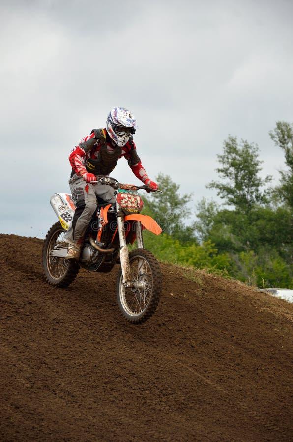 A motocross racer lands on the rear wheel stock photos