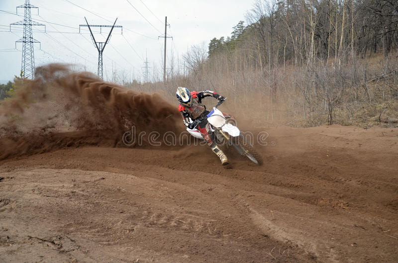 Motocross Racer Moves Along Sandy Parapet Turning Track Stock Image
