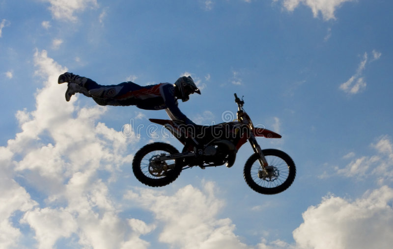 Motocross rider in the air royalty free stock photo
