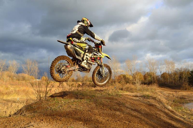 Motocross Rider on His Dirt Bike during Daytime stock photo