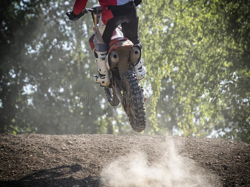 Motocross rider on a trail during a training stock photography
