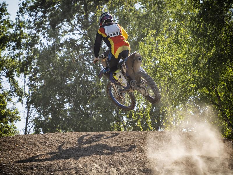 Motocross rider on a trail during a training stock photo
