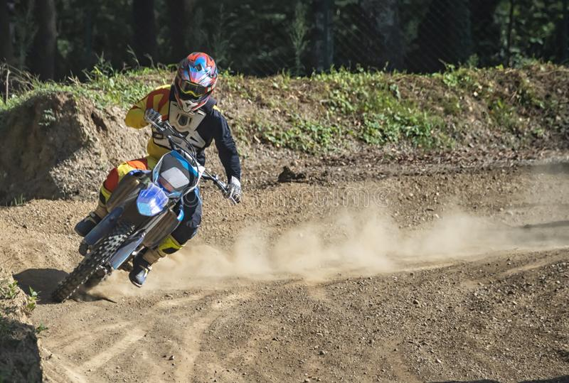 Motocross rider on a trail during a training royalty free stock image