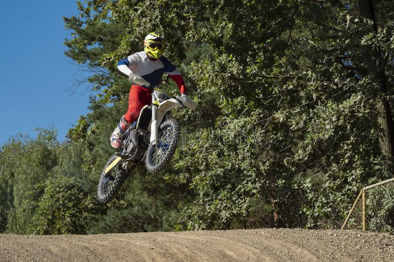 Motocross rider on a trail during a training royalty free stock photo