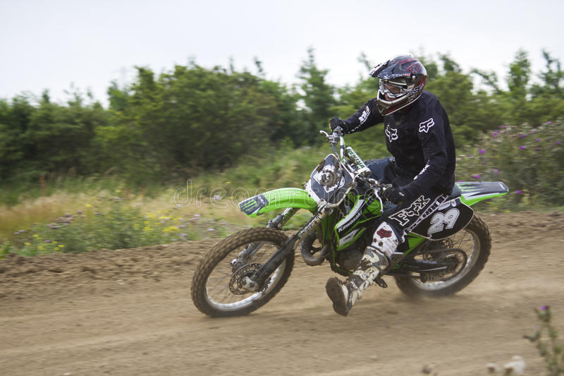Motocross Riders. Motocross riders practice at track at Cambois, Northumberland stock photo